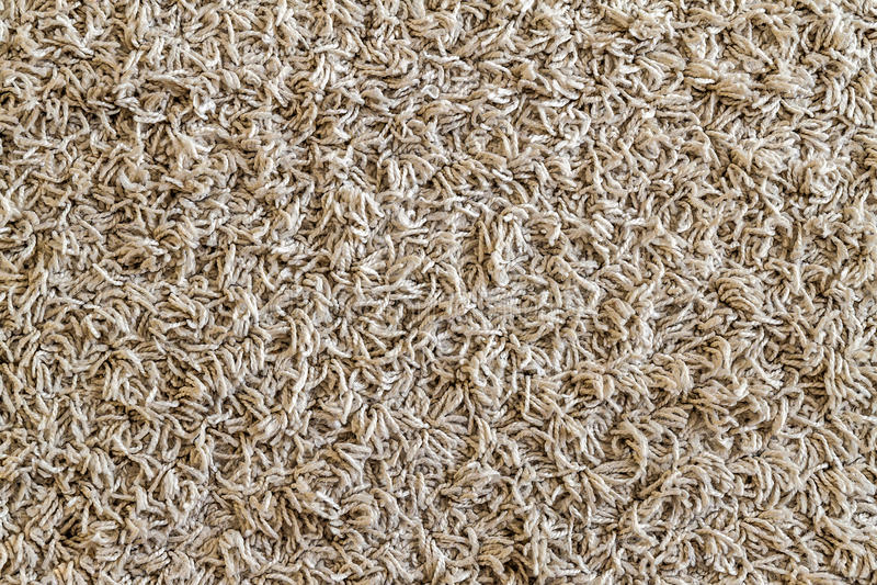 Hellgelbe rauhaarige Teppichprobe, eine Nahaufnahme schoss von Wolldecke backgro lizenzfreie stockbilder