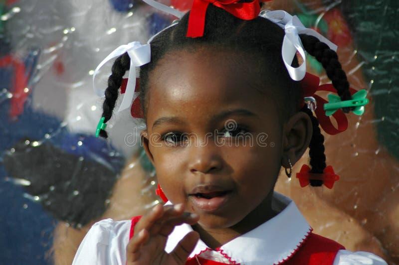 Hello. Young African American girl waving