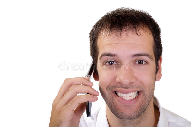 Hello. Portrait of a young happy man speaking on the phone royalty free stock photo