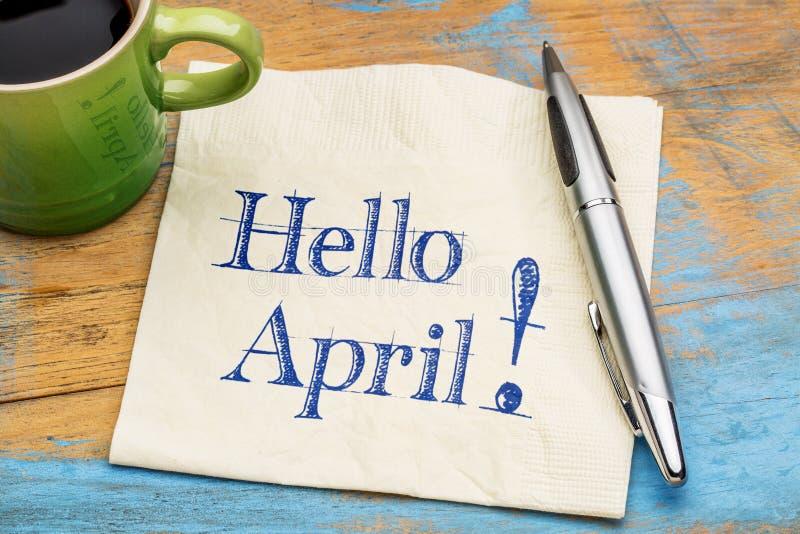 Hello April på servett med kaffe royaltyfri fotografi