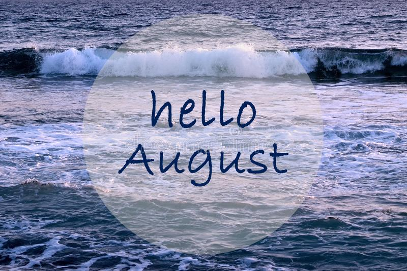 Hello August greeting on ocean waves background.Summer concept. Selective focus stock image