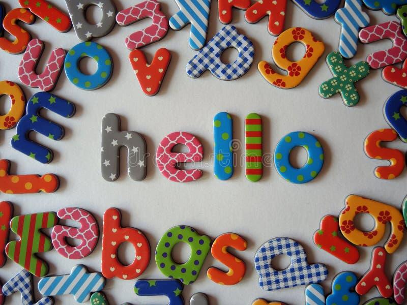 Hello-banner met kleurrijke brieven stock afbeeldingen
