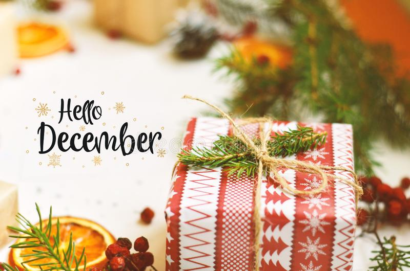 Hello December calligraphy inscription. Christmas decorations royalty free stock photo