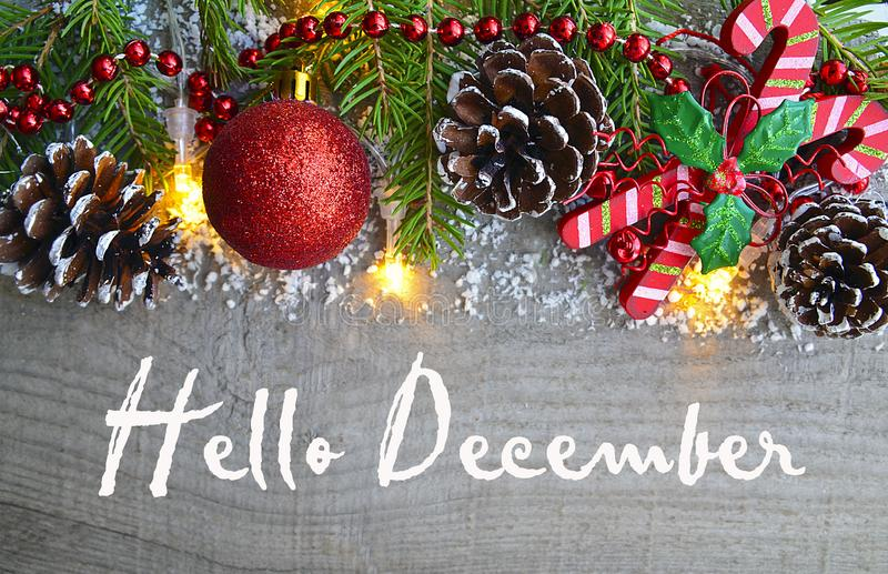 Hello December.Christmas decoration on old wooden background.Winter holidays concept. royalty free stock photo