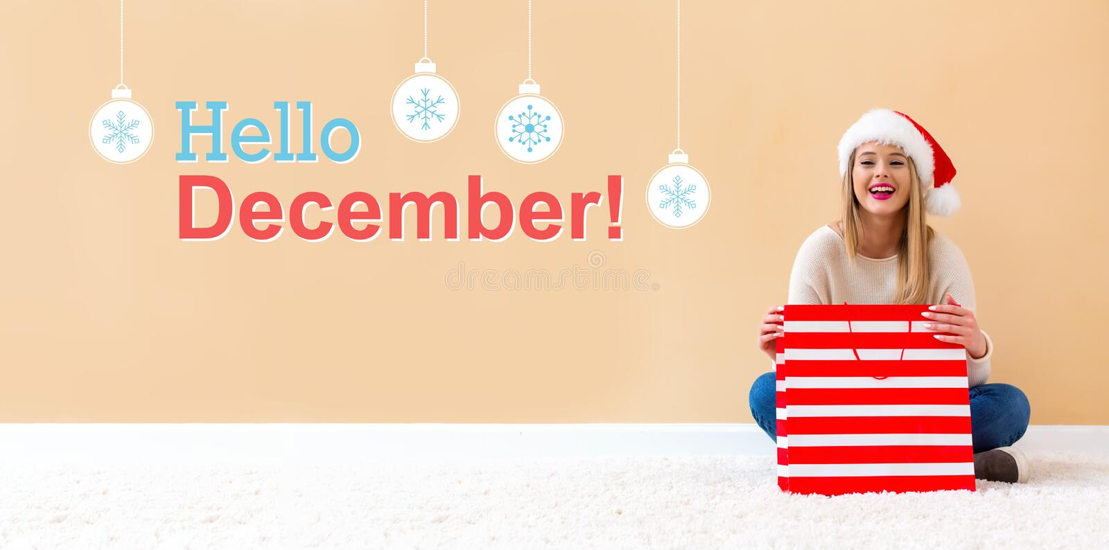 Hello December message with woman with Santa hat holding a shopping bag. Hello December message with happy woman with Santa hat holding a shopping bag stock images