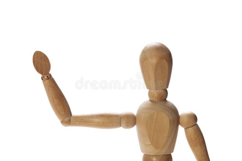 Hello, goodbye. Wooden mannequin waving hello or goodbye stock photo