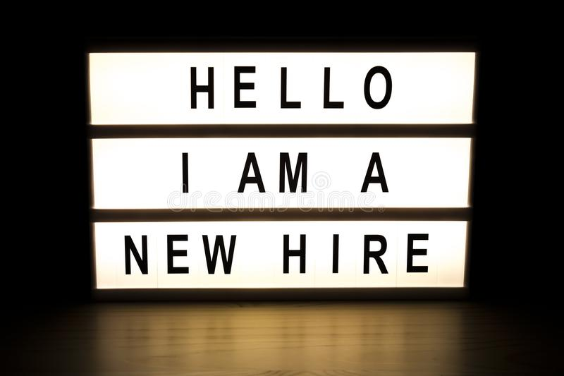 Hello I am new hire light box sign board. On wooden table stock photos