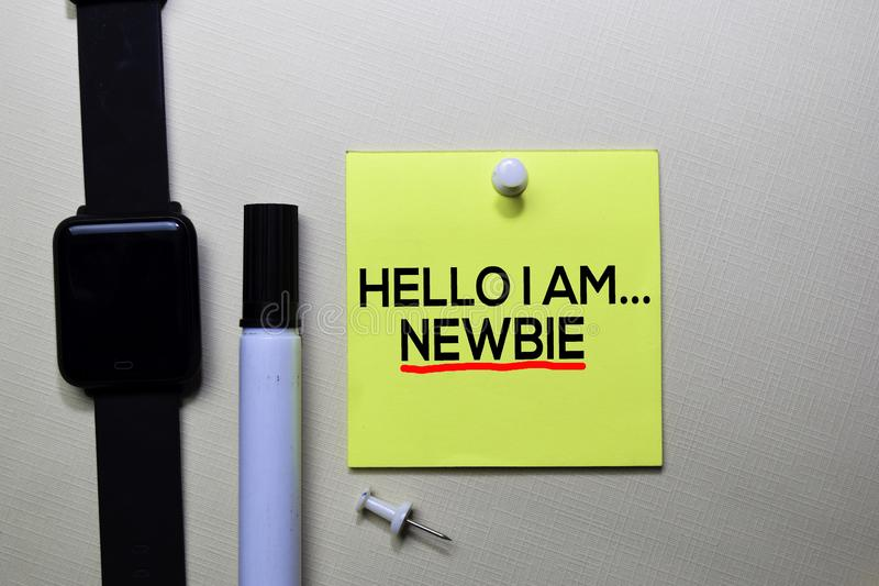 Hello I am Newbie text on sticky notes isolated on office desk stock image