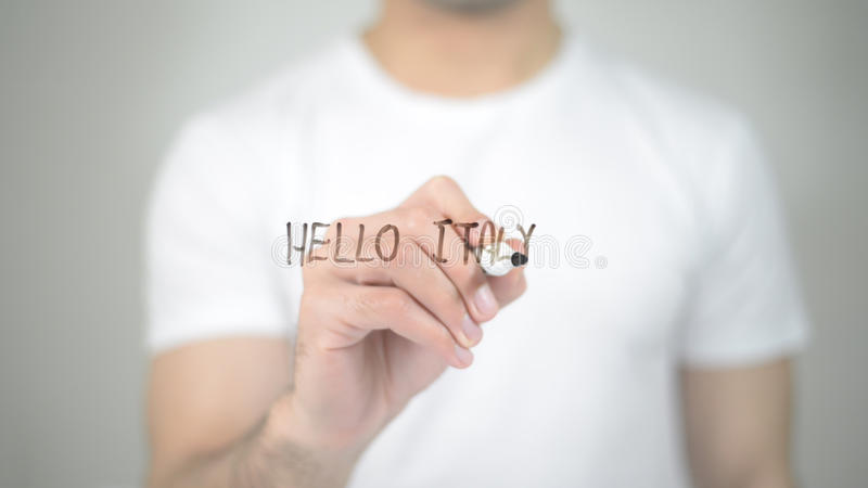 Hello Italy, man writing on transparent screen. High quality royalty free stock images