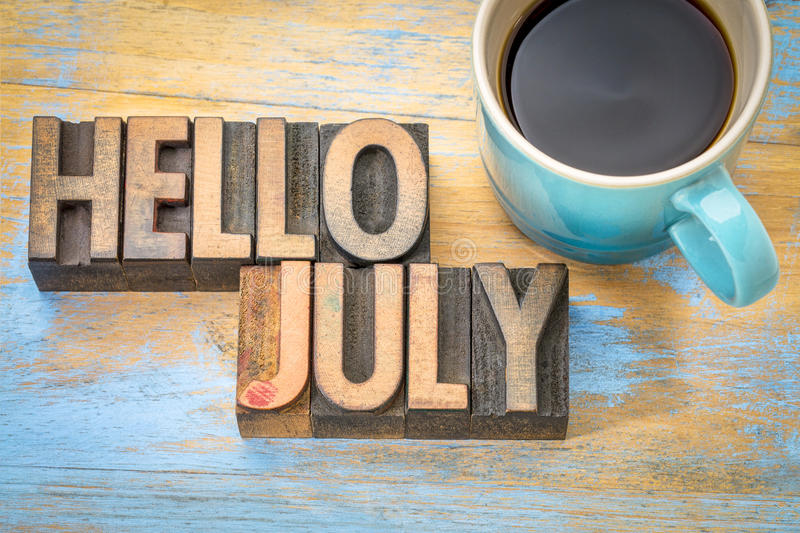 Hello July word abstract in wood type stock images