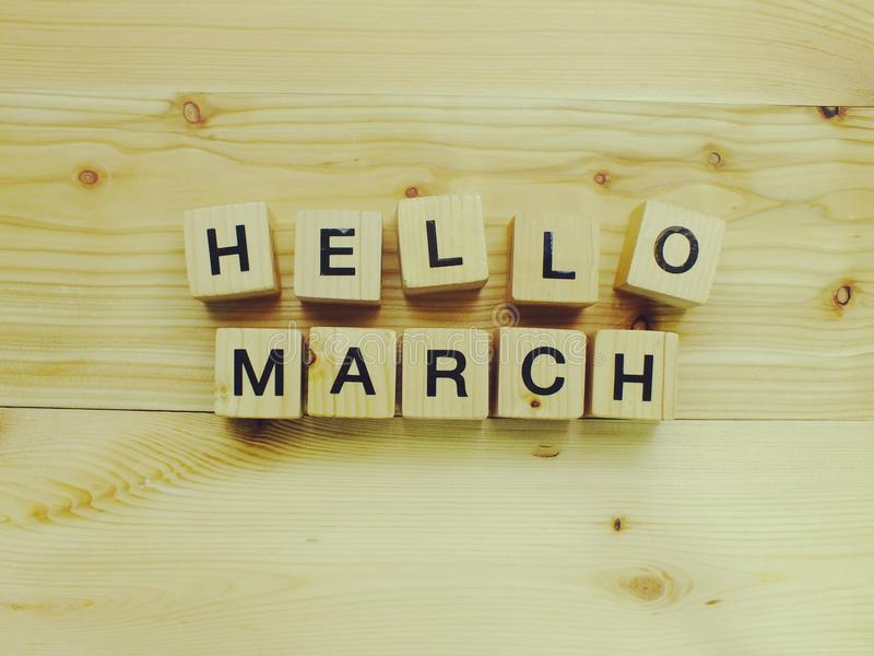 Hello march wooden block with filter color effect. Hello march wooden block on wooden background with filter color effect royalty free stock image