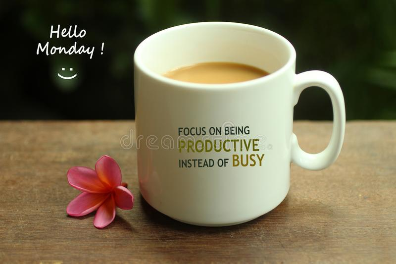 Hello Monday coffee. White mug of coffee and positive inspirational quote on it - Focus on being productive instead of busy. Morning coffee, with mug concept royalty free stock image