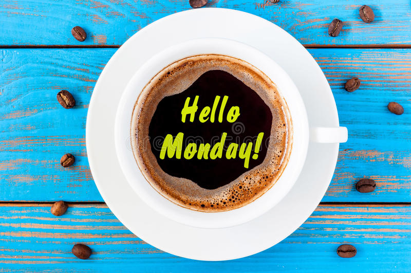 Hello Monday cup background on blue rustic wooden table. Morning concept.  stock photo