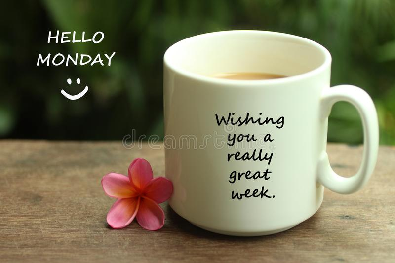 Hello Monday greetings with a smile face emoticon - Wishing you a really great week.  With white mug of coffee and notes on it. Morning tea or coffee with mug stock photos