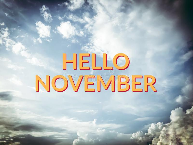 Hello November yellow word on sky and cloud background stock illustration