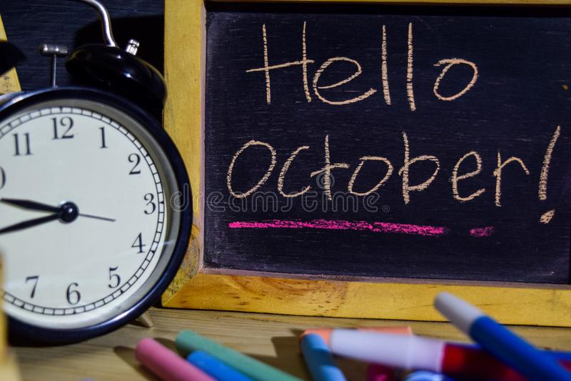 Hello october on phrase colorful handwritten on blackboard royalty free stock photos