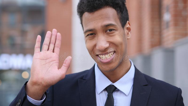 Hello Sign by Young African Businessman stock photo
