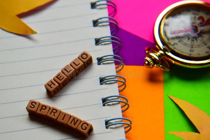 Hello spring message written on wooden blocks. Vacation and travel concepts. Cross processed image royalty free stock photo
