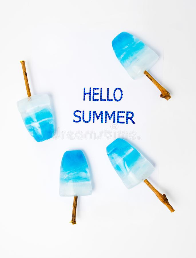 Hello summer card with blue popsicles royalty free stock photo