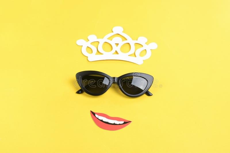 Hello summer The sun with stylish black sunglasses, smiling mouth on yellow background stock photo