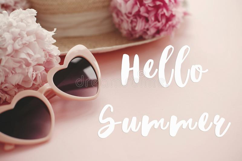 Hello Summer text sign on stylish girly pink retro sunglasses, white and pink peonies, straw hat on pastel pink paper. Summer vector illustration
