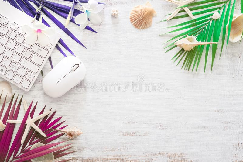 Hello summer travel vacation concept flat lay poster background concept. Hello Summer text on white wood background, wireless. Mouse keyboard with colorful stock image