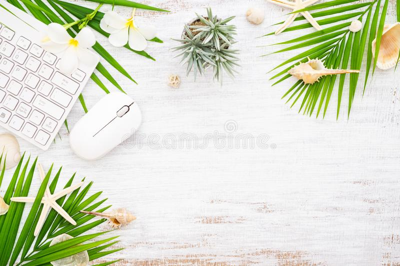 Hello summer travel vacation concept flat lay poster background concept. Hello Summer text on white wood background, wireless. Mouse keyboard with colorful royalty free stock photography