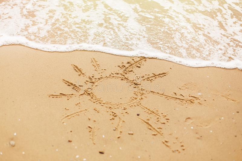 Hello summer vacation concept. Sun written on sandy beach and sea waves. Relaxing on tropical island. Let`s go travel royalty free stock photography