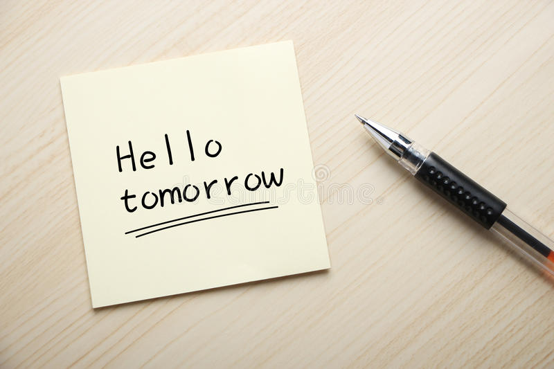 Hello Tomorrow. Text Hello Tomorrow written on the sticky note with pen aside royalty free stock photo