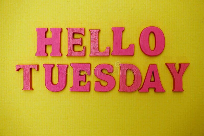 Hello Tuesday alphabet letters on yellow background. Hello Tuesday alphabet letters with space copy on yellow background stock photos