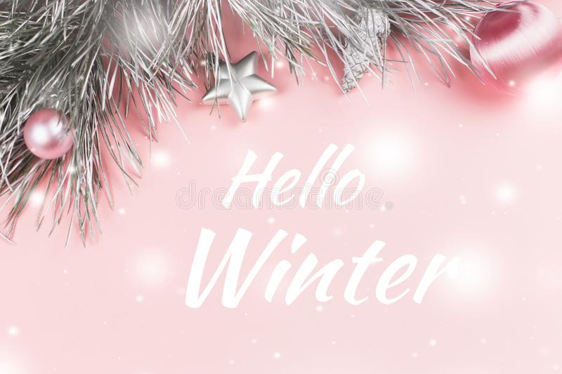 Hello winter greeting card with pastel pink Christmas background royalty free stock photo