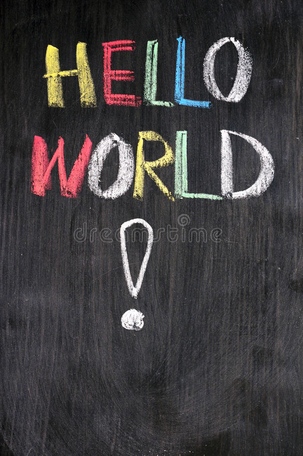 Hello World. Hello, World! - message from the first computer program written on blackboard royalty free stock image