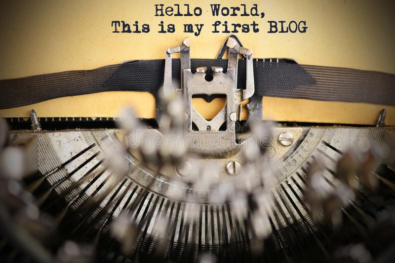 """""""Hello world, this is my first blog"""" introduction written with classic vintage typewriter on weathered paper royalty free stock photos"""