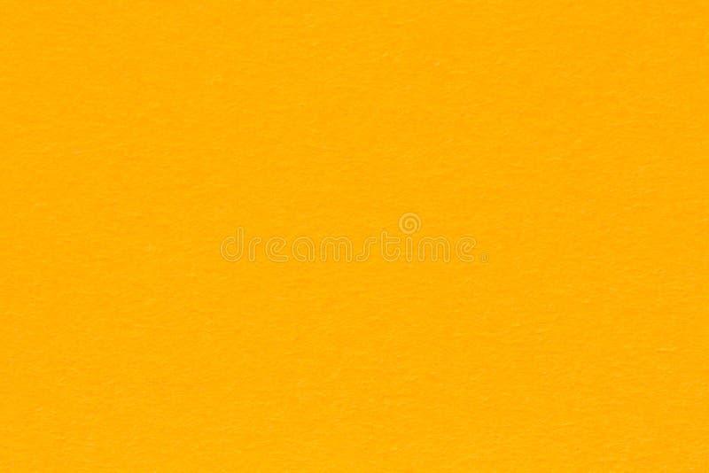 Hellorangeer Hintergrund der k?rnigen Papierbeschaffenheit Leuchtorangepapier lizenzfreies stockfoto