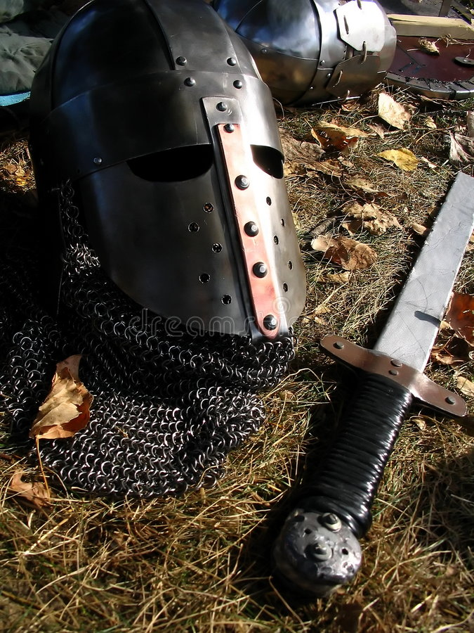 Helm and sword royalty free stock photos