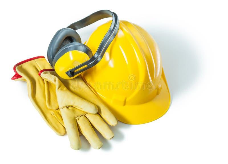 Helme und Handschuhe für Erdhörer, isoliert auf weißem Grund stockbilder