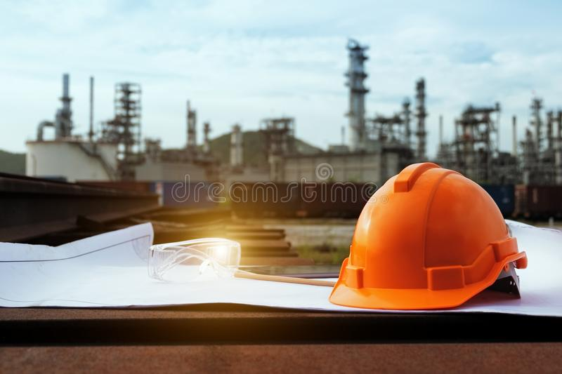 Helmet construction and safety glasses on the blueprint. stock photos