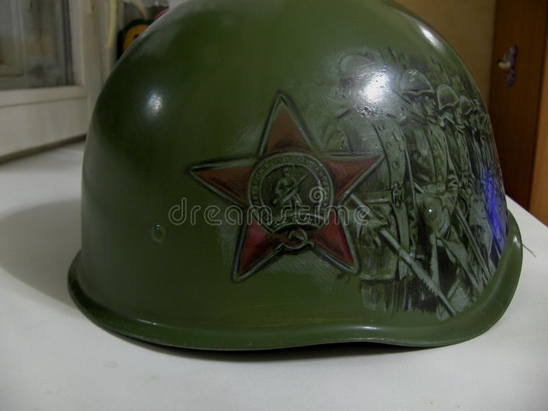 The helmet with the figure. stock photo