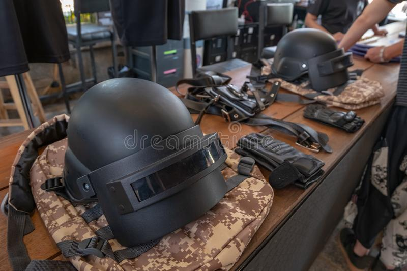 Helmet. Full cover helmet as online game`s item on the camouflage style bag stock photos