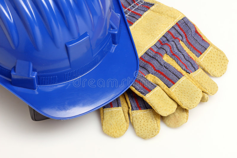 Helmet and gloves royalty free stock image