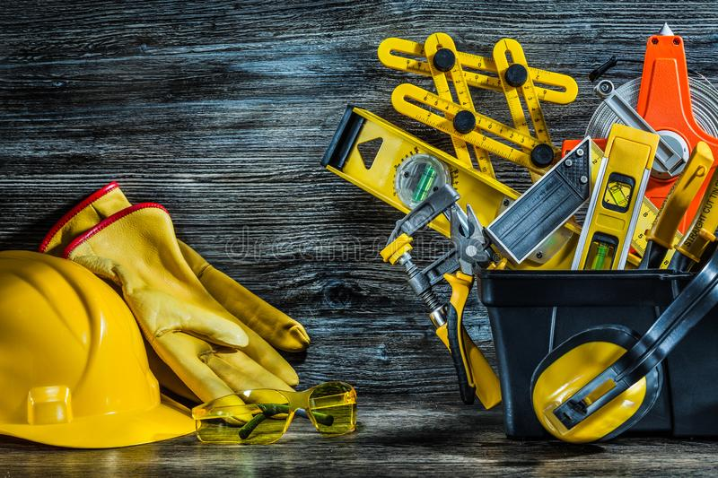 Helmet gloves glasses and set of tools in toolbox stock photography