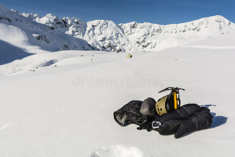 Helmet, ice axe and clothing down. royalty free stock images