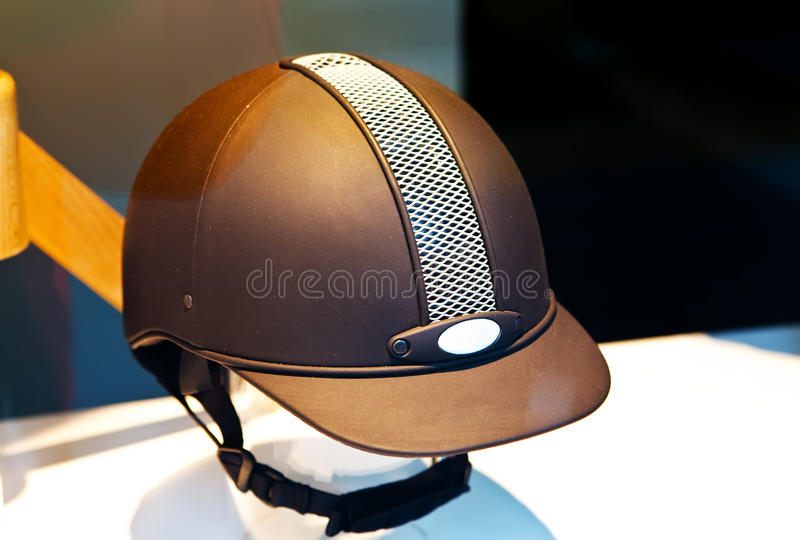 Helmet of the jockey. In a shop show-window stock photos