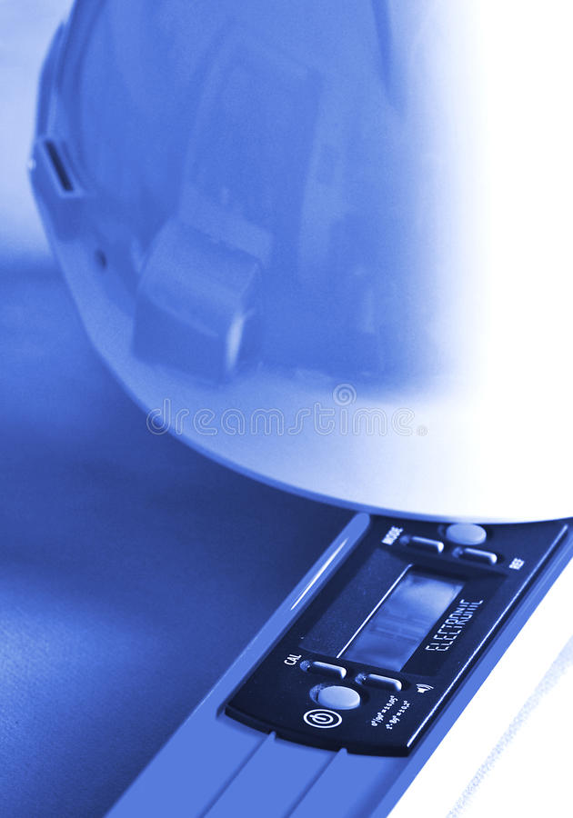 Download Helmet and level stock image. Image of building, document - 27663777