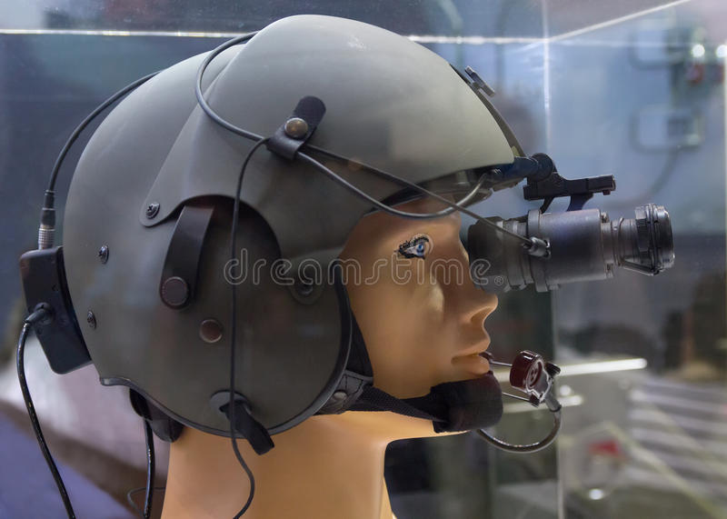 Helmet with night vision device on the demonstration mannequin. Weaponry royalty free stock photo