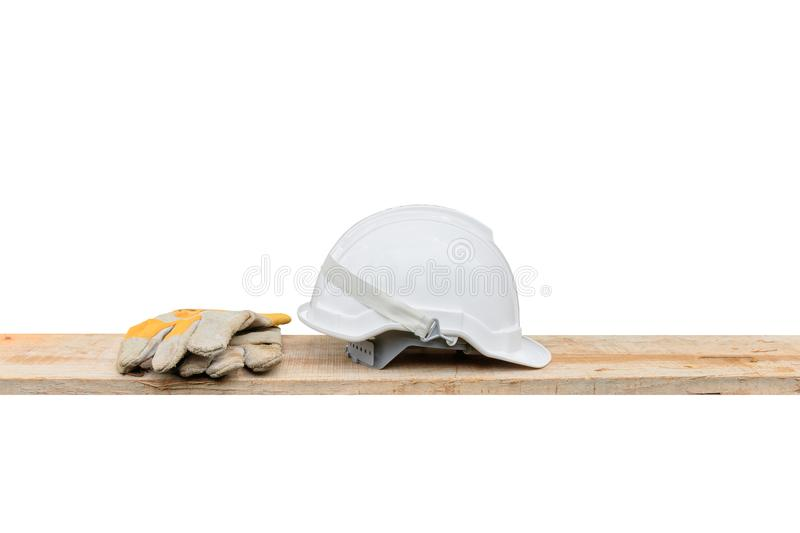 Helmet plastic white and leather glove safety equipment construction of engineering on Wooden floor isolated White background stock image