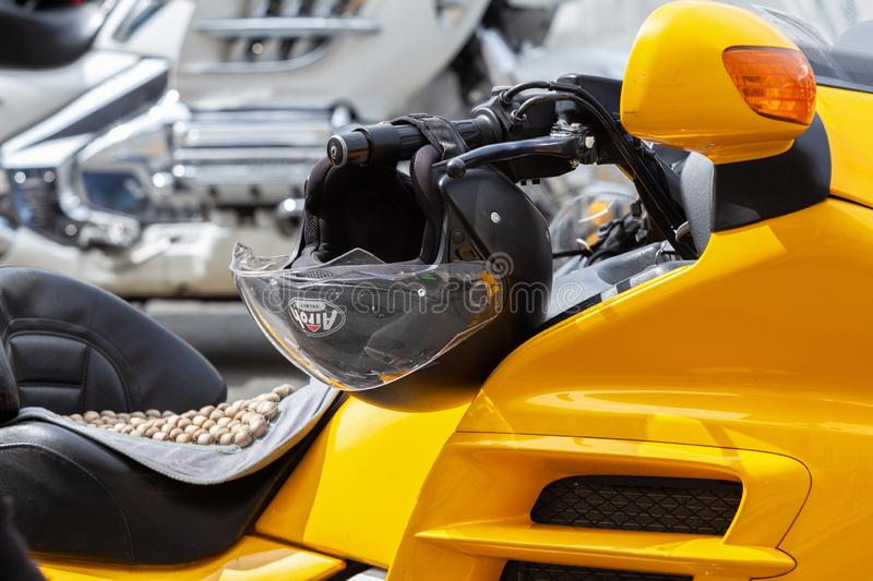 Helmet on the steering wheel of a beautiful powerful sports bright yellow motorcycle. Close-up royalty free stock photos
