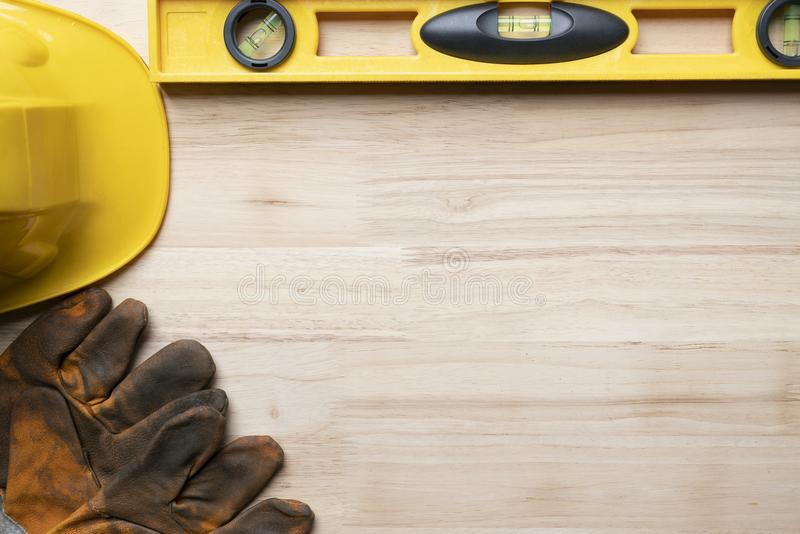 helmet, water level and gloves engineer desk background ,project ideas concept royalty free stock photo