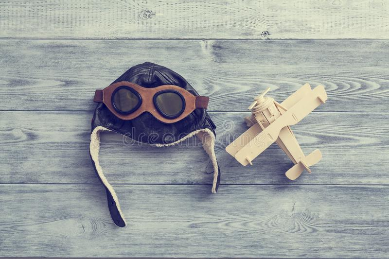 Helmet and wooden airplane. the concept of conquering the sky. Helmet and wooden airplane vintage style. the concept of conquering the sky royalty free stock images
