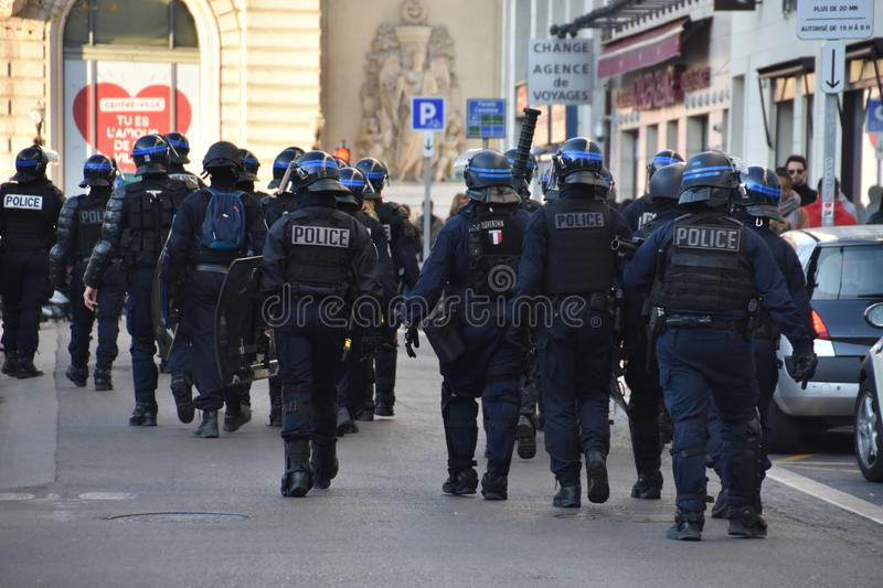 Helmeted police officers. Marseille, France - May 01, 2019 : Helmeted police officers photographed from behind during a protest royalty free stock images